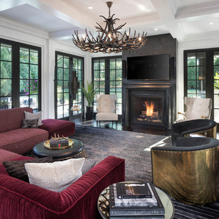 This is an example of a mediterranean family room in Minneapolis with a standard fireplace and a wall-mounted tv.