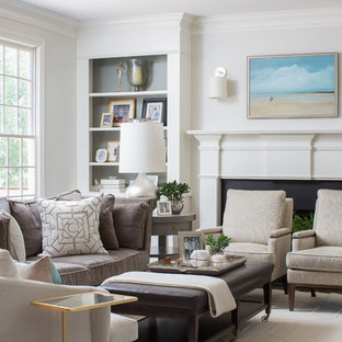 Transitional open concept family room photo in Atlanta with a standard fireplace and white walls