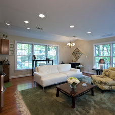 Traditional Family Room by Moss Building and Design