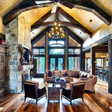 Rustic Family Room by Ellis Custom Homes LLC