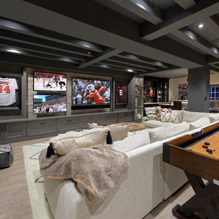 Example of a transitional open concept beige floor game room design in DC Metro with beige walls and a wall-mounted tv