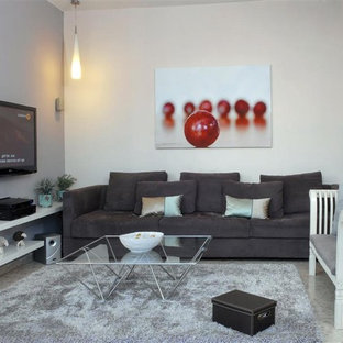 Inspiration for a contemporary family room remodel in Other with gray walls and a wall-mounted tv