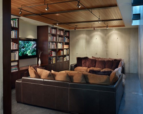 Inspiration For An Industrial Home Theater Remodel In Seattle With Gray Floors