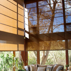 Contemporary Family Room by Insolroll Window Shading Systems