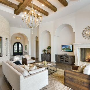 Example Of A Tuscan Medium Tone Wood Floor Family Room Design In Austin  With Beige Walls