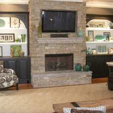 Eclectic Family Room by Luck Stone Center