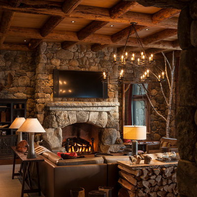 Inspiration for a rustic family room remodel in New York with multicolored walls, a standard fireplace, a stone fireplace and a wall-mounted tv