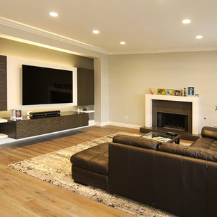 Inspiration for a mid-sized contemporary enclosed light wood floor family room remodel in Orange County with beige walls, a standard fireplace, a tile fireplace and a wall-mounted tv