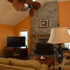 Rustic Family Room by Barbara Pettinella