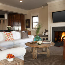 Tropical Family Room by Brown Contractors Fine Custom Homes