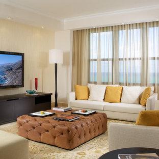 Réalisation d'une salle de séjour design de taille moyenne et ouverte avec un mur beige, un téléviseur fixé au mur, moquette et un sol multicolore.