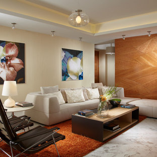 Inspiration for a contemporary open concept family room remodel in Miami with beige walls