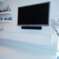 Modern Family Room by Anima Domus