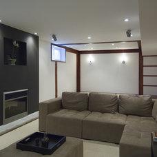 Asian Family Room by BiglarKinyan Design Planning Inc.
