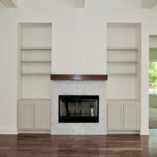 Transitional Family Room by Woodsman Kitchens and Floors