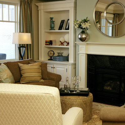 Family room - mid-sized traditional open concept family room idea in Toronto with a standard fireplace, a wood fireplace surround, a media wall and gray walls