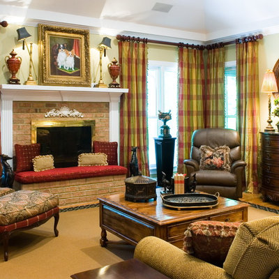 Elegant medium tone wood floor family room photo in Atlanta with beige walls, a standard fireplace, a brick fireplace and no tv