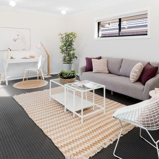 Photo of a mid-sized contemporary family room in Sydney with grey walls, carpet and grey floor.
