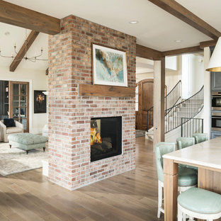 Family room - transitional open concept medium tone wood floor and brown floor family room idea in Denver with a music area, beige walls, a two-sided fireplace and a brick fireplace