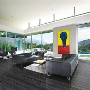 Idée de décoration pour une salle de séjour minimaliste de taille moyenne et ouverte avec un mur gris, un sol en bois foncé, aucun téléviseur et un sol noir.