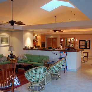 Inspiration for a tropical open concept family room in Hawaii with beige walls.