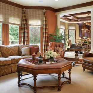 Réalisation d'une salle de séjour tradition ouverte avec un mur orange.