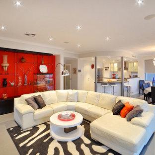Idee per un soggiorno design con pavimento in gres porcellanato e pareti rosse