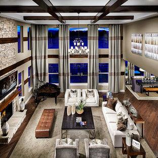 Ispirazione per un ampio soggiorno minimal aperto con pareti beige, parquet scuro, camino classico, cornice del camino in pietra e TV a parete