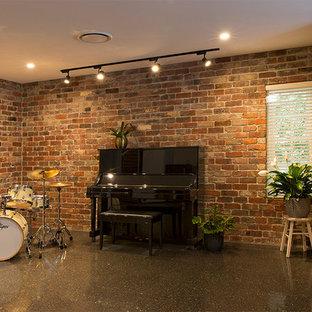 Idéer för industriella allrum med öppen planlösning, med ett musikrum, betonggolv och grått golv