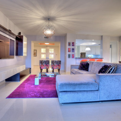 Mid-sized trendy open concept porcelain tile family room photo in Miami with gray walls and a wall-mounted tv