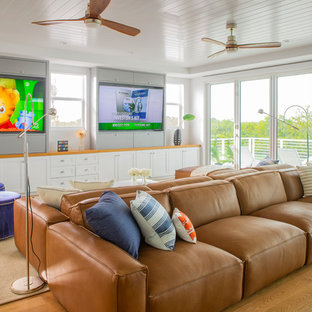 Inspiration for a medium sized nautical open plan family and games room in Miami with a built-in media unit, white walls, medium hardwood flooring and brown floors.