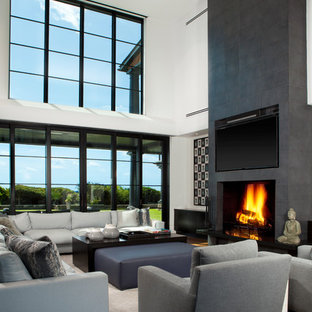 Example of a trendy open concept family room design in Charleston with white walls, a standard fireplace and a wall-mounted tv