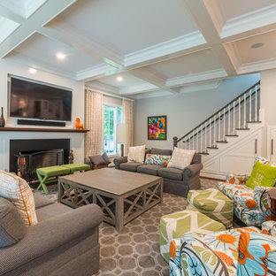 Inspiration for a transitional family room remodel in Raleigh with beige walls and a standard fireplace
