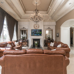 Example of a large tuscan open concept marble floor and beige floor family room design in Toronto with beige walls, a two-sided fireplace, a stone fireplace and a wall-mounted tv