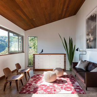 Mid-sized midcentury enclosed family room in Sydney with white walls, travertine floors and brown floor.