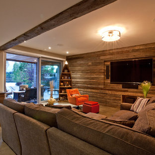 Inspiration for a contemporary concrete floor family room remodel in Vancouver with multicolored walls and a media wall
