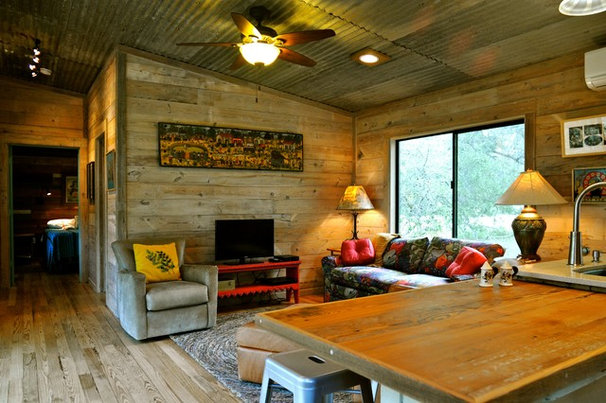 Rustic Family Room by Reclaimed Space