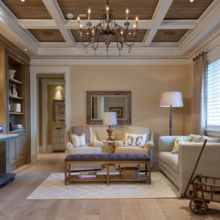 Example of a classic light wood floor family room design in Miami with beige walls and no tv