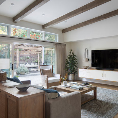 Inspiration for a mid-sized transitional open concept brown floor and medium tone wood floor family room remodel in San Francisco with white walls, no fireplace and a wall-mounted tv