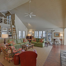 Rustic Family Room by Envision Web