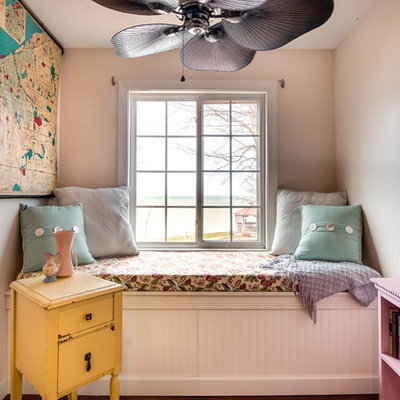 Inspiration for a farmhouse family room library remodel in Cleveland with pink walls