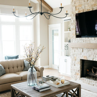 Family room - large farmhouse enclosed light wood floor and brown floor family room idea in Detroit with beige walls, a standard fireplace, a stone fireplace and a media wall