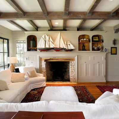 Example of a mountain style medium tone wood floor family room design in Dallas with beige walls, a standard fireplace and a brick fireplace