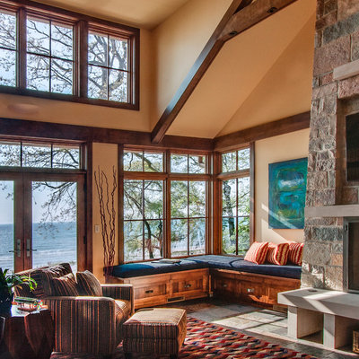 Mountain style family room photo in Milwaukee with a stone fireplace