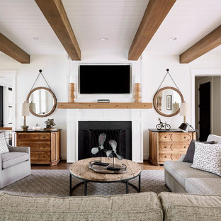 Inspiration for a beach style family room remodel in Raleigh with white walls, a standard fireplace and a wall-mounted tv