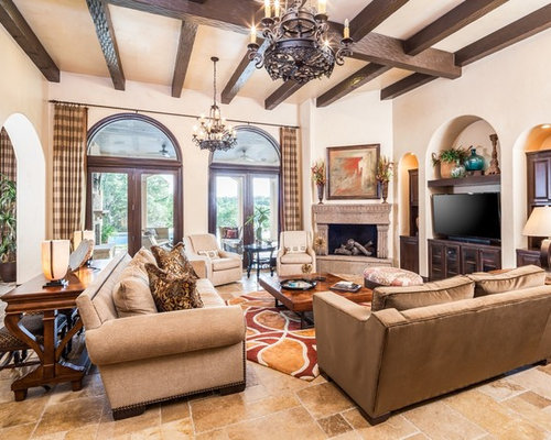 Example Of A Tuscan Living Room Design In Houston With Beige Walls Corner Fireplace
