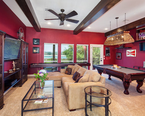 Example Of A Classic Family Room Design In Austin With Red Walls