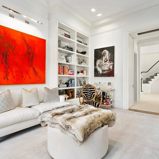 Transitional enclosed medium tone wood floor and brown floor family room photo in New York with white walls