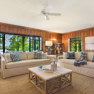 Example Of A Huge Coastal Enclosed Medium Tone Wood Floor Family Room Design In New York