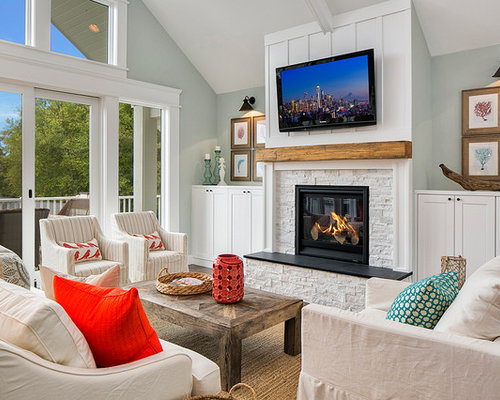 Example Of A Coastal Family Room Design In Seattle With Blue Walls Standard Fireplace